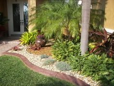 tropical flower bed, fill with rocks instead of mulch or pine straw