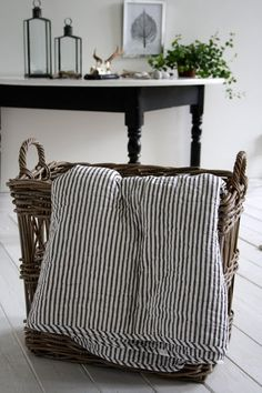 Natural and neutral, basket and striped blanket.