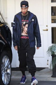 Tyga wearing  The North Face X Supreme Denim Short Jacket, Vintage In Memory Of Aaliyah Try Again T-Shirt, Nike X Stüssy Air Max 95, Last Kings Bling Necklace
