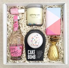 The Birthday! - Birthday cake scented candle with wax confetti by The Little Market Cake scented bath bomb with sprinkles by Da Bomb Fizzers with hidden surprise inside! One gold celebratory shot glass by W&P Design One bottle of pale pink Essie nail polish Bottle of Elderflower & Rose Lemonade Willa's shortbread cookies wrapped in a colorful geometric print Perfect Birthday Gift! One of our most popular!