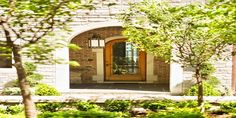 Stone Houses Exterior Design with Exterior Stone Archway and Wooden Front Door