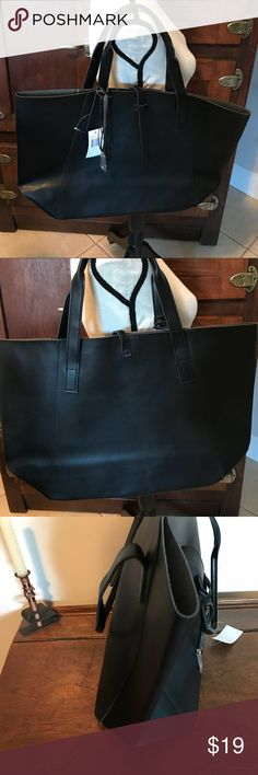 "~Black~ Tote Sam's 5th Avenue Large NWT tote that has a leather strap closure, and folds for storage. Leather cords with a letter ""J"" in golden metal that's enclosed in plastic.  12"" Tall, 10"" Wide, 6.5"" Deep with an approximately 6"" drop.  Thanks for perusing my closet! ✨💜Roni V/ggw Saks 5th Avenue Bags Totes"