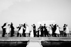 the happy couple kissing while the wedding party dances - photo by Dallas based destination wedding photographer Poser