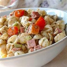 Antipasto Pasta Salad | A delicious pasta, meat and cheese combination with a homemade dressing. It serves a crowd and is great for a picnic.