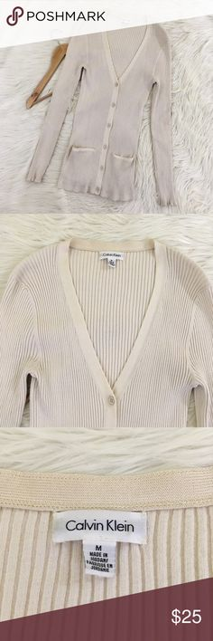 """Calvin Klein Cream Ribbed Knit Boyfriend Cardigan Calvin Klein Women's Medium Ribbed Cardigan  Length: 28"""" Armpit to armpit: 13"""" - 20""""  • Beige/Cream • V-Neck • Thin Knit • Rayon Blend • SUPER stretchy • Excellent condition, no flaws Calvin Klein Sweaters Cardigans"""