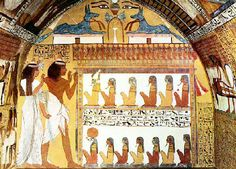 The western wall is devoted to death. Sennedjem and his wife Iyneferti resurrected after triumphing the underworld of Osiris come up, arms raised, before the gods gathered in a palace topped with a frieze of 24 uraei (the 24 hours). the thirteen represented deities symbolizing the court of Osiris (top leader) and Harmakhis (leading down) which are the gods of the Duat .