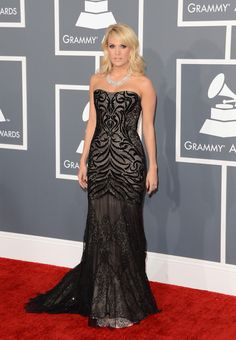 2d2de49ab64 Carrie Underwood in a black Roberto Cavalli gown at the 2013 Grammy Awards  Grammy Red Carpet