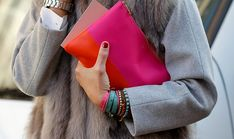 From day to night and work to play, a colorful clutch has got you covered.