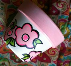 Check out this item in my Etsy shop https://www.etsy.com/listing/225774731/hand-painted-terracotta-pot-beautiful