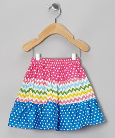 Pepped up with polka dots, zigzags and an elastic waistband, this energetic skirt teems with twirlability.