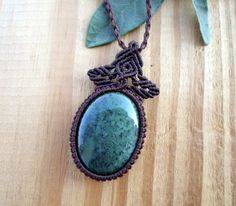 This unisex micro macrame pendant features a gorgeous Moss Agate cabochon, set with high quality dark brown wax thread. The pendant is hanged in a handmade cord which is adjustable so it can be long or short.The wax thread is very strong and feels very natural, it also maintains its color and shape for many years.  The Moss Agate cabochon is 4 x 3 Cm ( 1.57 x 1.18 Inches ).  The pendant will be sent in a beautiful handmade jewelry box .  We ship through ELTA with a Tracking Number.  To see…