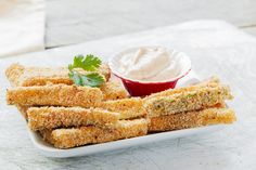 These baked zucchini sticks make for a great side item for most dinners. They are pretty easy to make and are also much healthier when compared to frying zucchini sticks. Sub nutritional yeast for parm cheese Baked Zucchini Sticks, Zucchini Fries, Easy Poached Eggs, Dinner Is Served, Russian Recipes, Recipe Details, Oven Baked, Baked Ziti, Vegetable Side Dishes