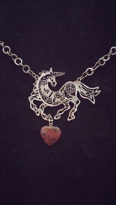 Unicorn with mahogany obsidian heart!