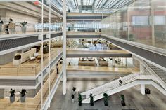 A floor rises continuously on a subtle slope from the ground level as it wraps around the skylit central atrium, creating an open daylight-filled space for 800 workstations  Building 337 | Rafael Viñoly Architects