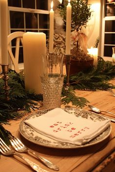 White candles with evergreens