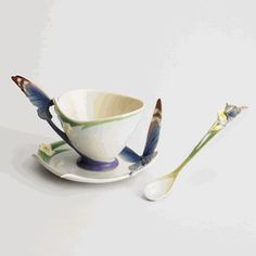 Butterfly design sculptured porcelain blue cup/saucer set, and spoon