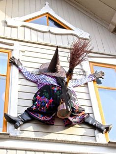 My hubby is getting on board with the Halloween decoration ideas. He wants to do this between our windows.