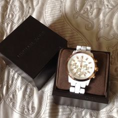 Michael Kors watch Authentic Michael Kors watch. White ceramic with rose gold face. Battery needs replacement. Michael Kors Accessories Watches