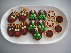 Decorate pre-bought biscuits with chocolate and lollies to give them a festive touch. For those that don't have time to bake!