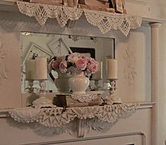 Pretty doilies...  Using books for height in the display