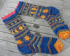 Sun and Moon socks complete by Lynn Hall, via Flickr