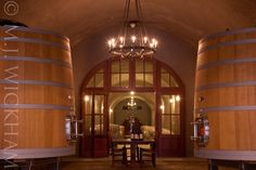 Grand oak casks line the entrance to @staglinwine caves in Rutherford, Napa Valley