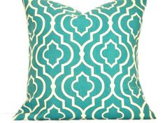 i bought these and i LOVE them!  Turquoise Pillow Covers Moroccan Quatrefoil White Decorative Geometric Pair 16x16. $28.00, via Etsy.