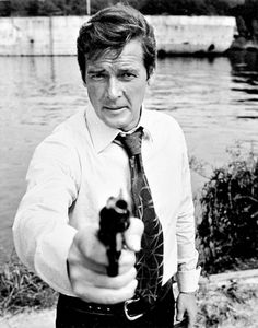 Roger Moore AKA The Saint and 007 Roger Moore, James Bond Style, Bond Series, Spy Who Loved Me, James Bond Movies, Sean Connery, Portraits, Movie Photo, British Actors
