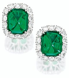 FINE PAIR OF EMERALD AND DIAMOND EAR CLIPS.        Each set with a cushion-shaped sugar loaf cabochon emerald weighing approximately 9.58 carats, framed by brilliant-cut diamonds altogether weighing approximately 6.50 carats, mounted in platinum. Sotheby's.