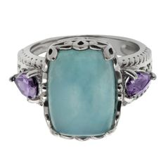 This sterling silver 14x10mm cushion shaped aquamarine and amethyst ring is elegance in its finest form. The aquarmarine stone is prong set with a gorgeous decorative shank.