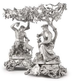 """A pair of Victorian silver figural """"grape arbor"""" tazze, John Samuel Hunt for Hunt & Roskell, London, 1848 with figures of a goatherder and his companion under dish-form vine arbors, grapevine base rims marked throughout, bases stamped HUNT & ROSKELL LATE STORR MORTIMER & HUNT / 3998 height 12 in."""