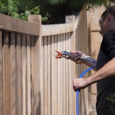 Staining a fence with a brush can be a daunting task. Save time and headaches on your next fence-staining project using an airless paint sprayer. Diy Fence, Backyard Fences, Backyard Projects, Outdoor Projects, Garden Projects, Backyard Landscaping, Outdoor Ideas, Diy Projects, Privacy Fence Designs