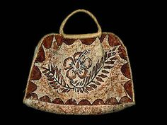 Siapo tapa cloth purse, made from cloth mulberry tree bark and woven fronds of the pandanus tree.