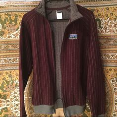 Price Drop  Patagonia jacket Maroon Patagonia jacket. Wool. Comfy and warm. Size medium men's but even cuter for girls. Tiny stain pictured. Patagonia Jackets & Coats