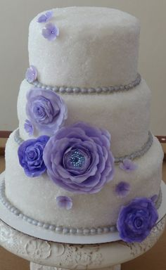 Sparkle Wedding cake with Purple flowers by Tea Party Sweets