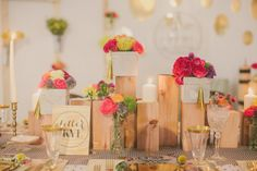 Love this modern rustic centerpiece: 2x4s, cut to various lengths, stood on end in a grouping for holding candles || THE CREAM EVENT – Glitter + Rye