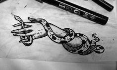 snake hand tattoo