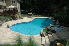 pool patio too hot concrete paver slabs looks like stone and low heat, concrete masonry, decks, outdoor living, patio, pool designs, spas, Freeform vinyl liner pool with steps up to the spa patio