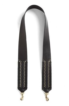 Switching out the traditional bag strap for this gorgeous leather Rebecca Minkoff guitar strap to complete that rocker-chic look.