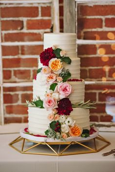 Pretty white #weddingcake with real #flower accents | @blisseventsid. #wedding #white  Photos by Double Take Photography