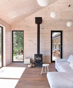 A Lakeside Cottage Gets a Modern Addition by Anik Péloquin architecte - Design Milk Casas Containers, Traditional Style Homes, Lakeside Cottage, Beautiful Living Rooms, Home Additions, Living Room With Fireplace, Fireplace Design, Cabin Interiors, Black House