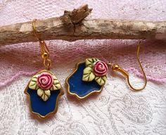 Hamsa hand. blue dangle earrings. judaica jewelry. hand earrings. hamsa jewelry. blue earrings. hamsa. rose earrings. shabby chic earrings by ArgamanOsnatt on Etsy https://www.etsy.com/listing/240103883/hamsa-hand-blue-dangle-earrings-judaica