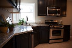 Brand new granite counter tops and maple cabinets in this remodeled Kitchen!