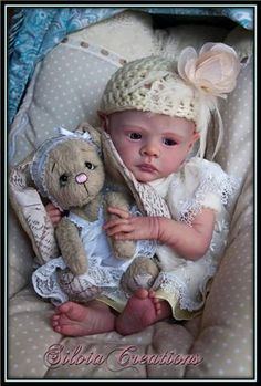 Sweet doll ~ Love that bear.