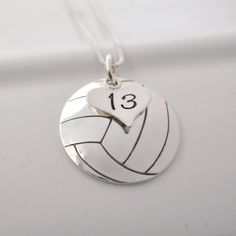 Perfect for a volleyball fan or player, this pendant is a 3/4 inch circle hand-stamped and domed to become a volleyball. A small heart charm