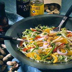 Singapore Slaw - Sweet peppers and oranges color this tangy slaw, which is tossed with a sesame dressing. Double this recipe for a potluck salad