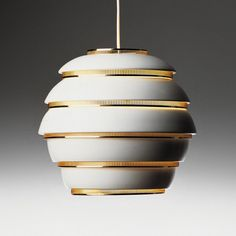 This is a White Vintage Lamp by Artek, from Alvar Aalto. And This lamp looks like one in the Agency Office of Mad Men.