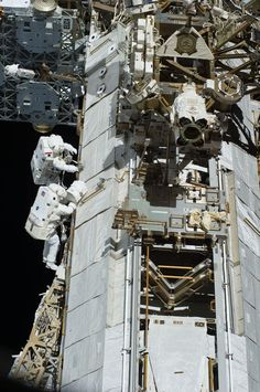 Astronomy - Space Vehicles: ISS crew members during EVA.