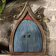 I'm totally going to have many gnome and fairy doors in my future backyard