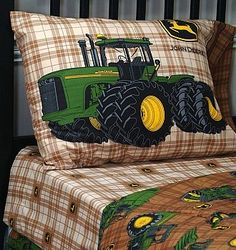"""Rye loved his John Deere bedding that Santa brought him this yr! he loves sleeping in his """"tractor bed"""" ha."""